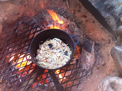 Bacon, onions and rice cooking in a cast iron pan, with maybe just a splash of bourbon.