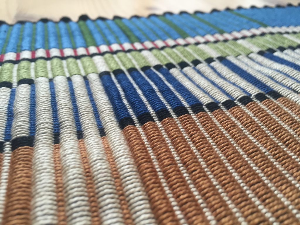 Detail of Prairie Style/Frank Lloyd Wright-inspired rep weave rug